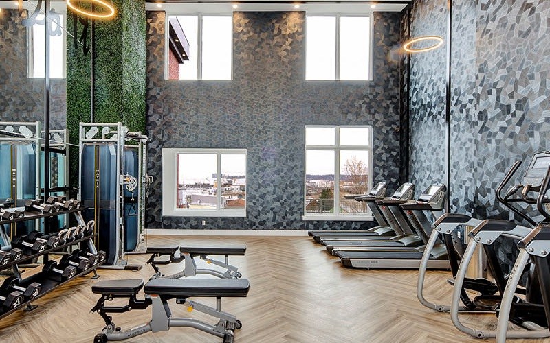 State-of-the-Art Fitness Center with high ceilings and large windows